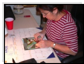 Ana Maria working on her 'Rufus Hummingbird' mosaic picture. Ana's art and jewelry is available in Marysvale Utah.